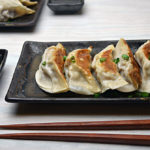 Pork Potstickers with Spicy Dipping Sauce
