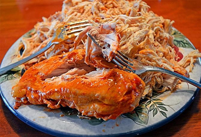 Shredding Crockpot Buffalo Chicken
