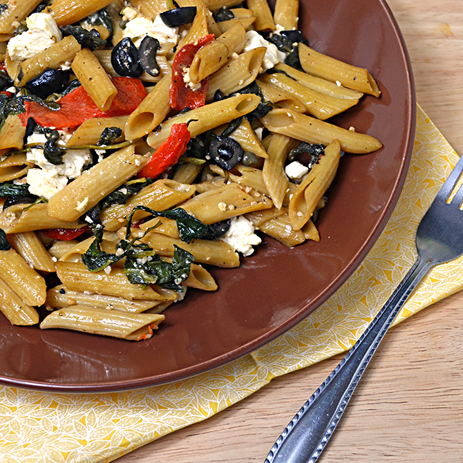 Pasta Greco-- Penne with spinach, feta cheese, roasted red peppers, capers, black olives, and garlic
