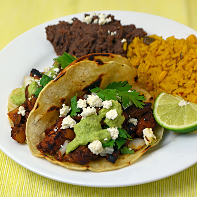 Tacos Al Pastor-- the tastiest tacos ever made.