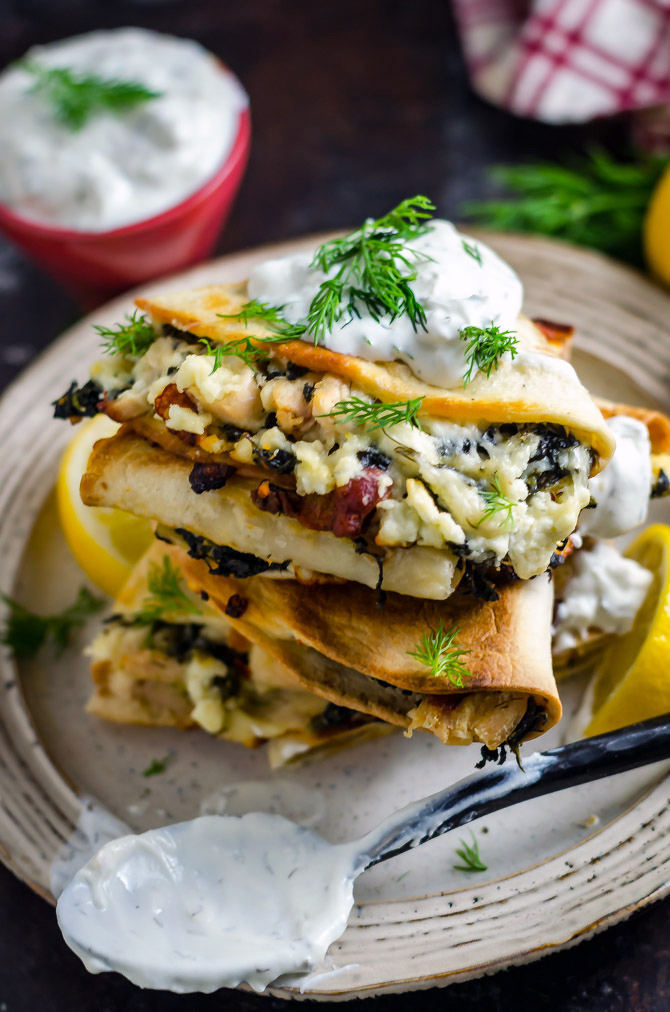 Freezer-Friendly Athenian Chicken Quesadillas. Load these Greek-inspired quesadillas up with tangy marinated chicken, bacon, feta and mozzarella cheeses, and spinach, and then dig in... or save them for later! Great for meal prep.   hostthetoast.com