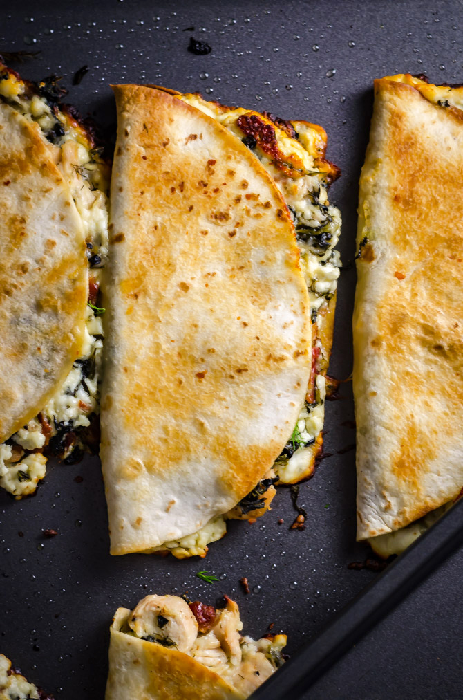 Freezer-Friendly Athenian Chicken Quesadillas. Load these Greek-inspired quesadillas up with tangy marinated chicken, bacon, feta and mozzarella cheeses, and spinach, and then dig in... or save them for later! Great for meal prep. | hostthetoast.com