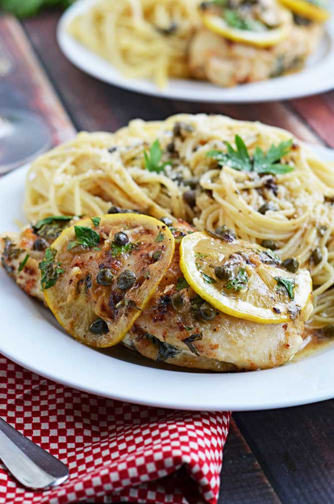 "Spinach and Ricotta Stuffed ""Chicken Piccata""-- Tender chicken breast stuffed with spinach and ricotta, served piccata style in a lemon, white wine, caper sauce.  Perfect for Valentine's Day!"