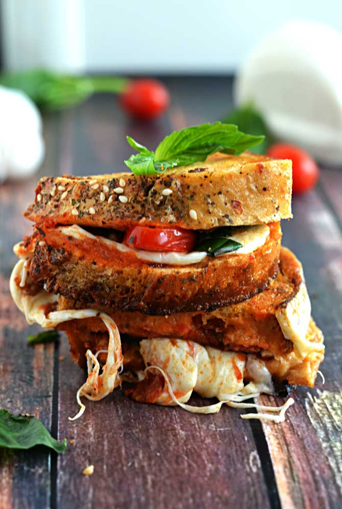 Garlic-Rubbed Margherita Pizza Grilled Cheese.  Who could resist pizza-fying an old favorite? | hostthetoast.com