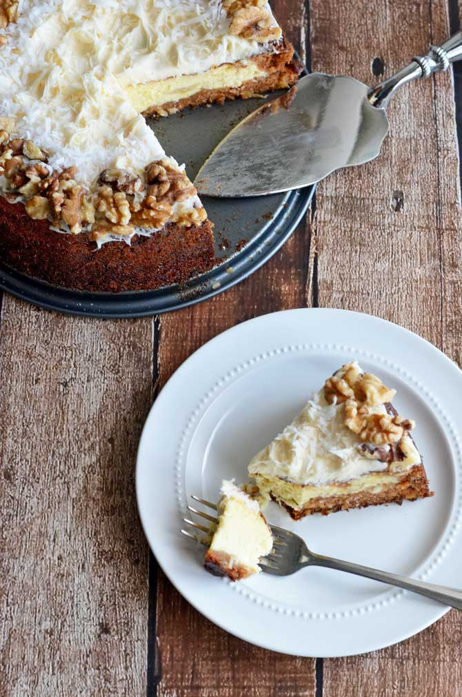 Carrot Cake Cheesecake.  Why choose between your two favorite desserts?  Combine them with this delicious recipe!  | hostthetoast.com
