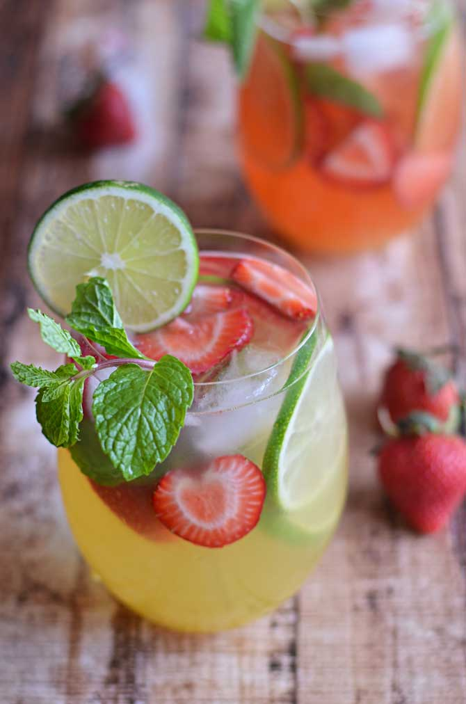 Mango Strawberry Sangria- sip on this fruity wine-based cocktail as you lounge in the sun! | hostthetoast.com