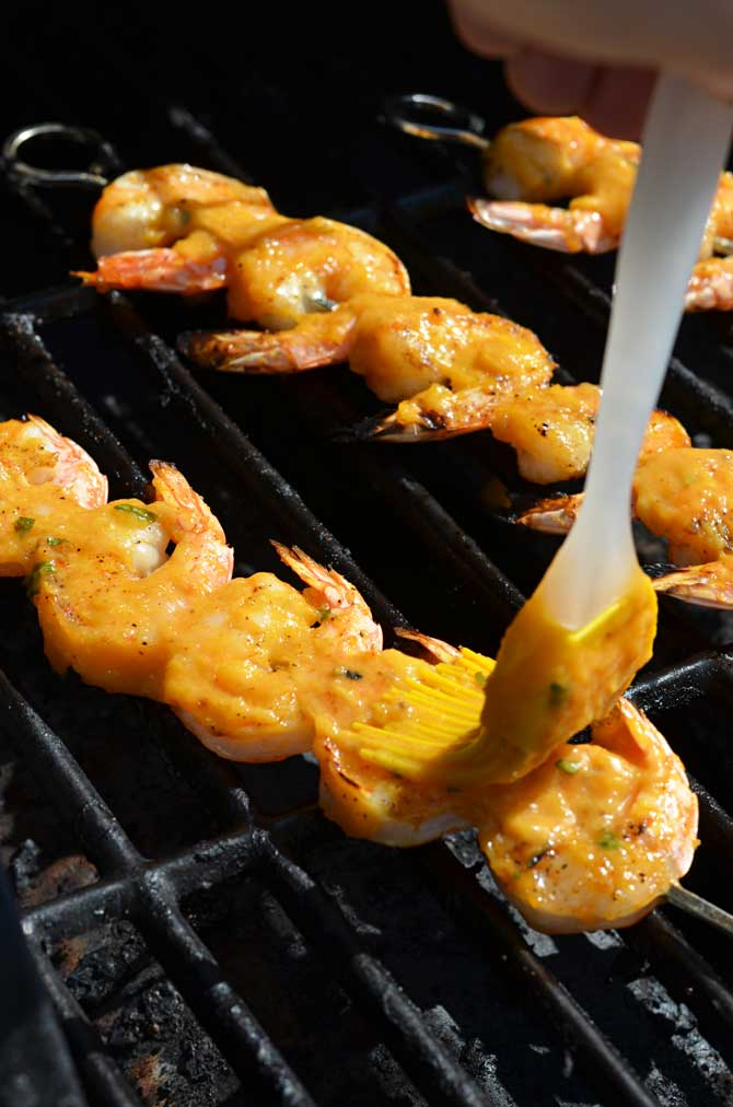 Mango Chile Glazed Shrimp.  Sweet, spicy, and grilled to perfection, these shrimp will be a new summer favorite! | hostthetoast.com
