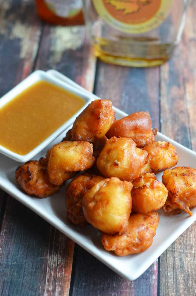 Maple Waffle Chicken Nuggets.  These chicken nuggets are coated in maple-y waffle batter and served with a honey maple mustard dip.  Perfect for parties or game day! | hostthetoast.com