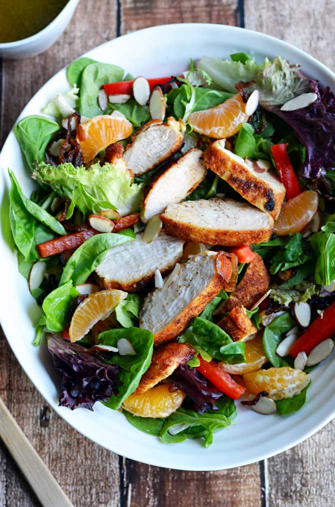 Cumin Honey Citrus Chicken Salad.  Cumin-rubbed chicken, clementines, almonds, crispy shallots, red bell pepper, & fresh greens unite in this tasty salad!  Covered in Honey Citrus Dressing, it's bound to be a favorite. | hostthetoast.com