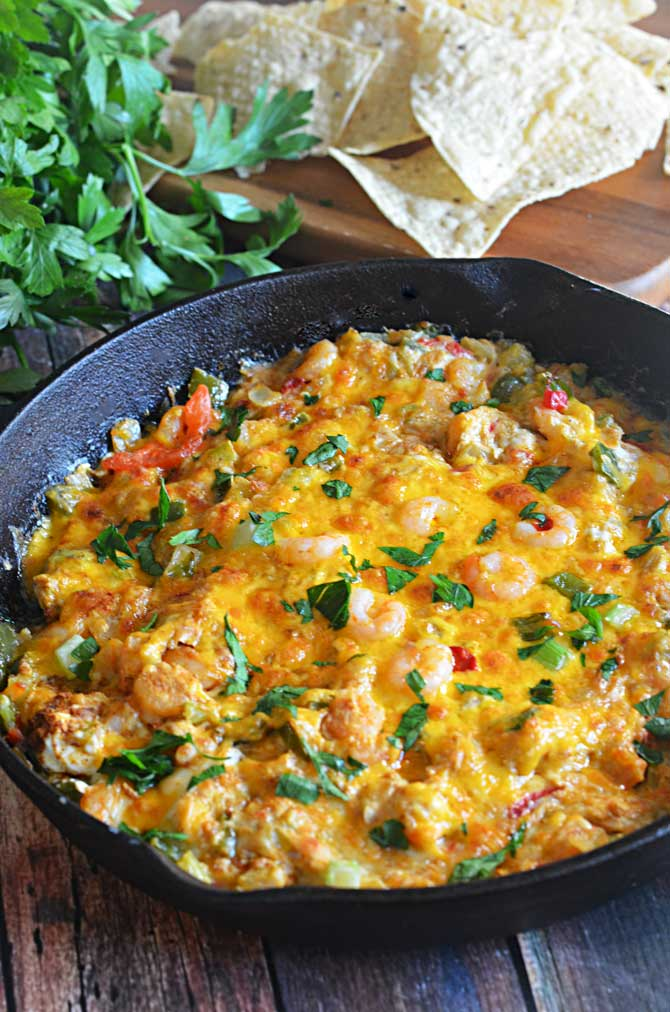 Cajun Shrimp Dip.  Amazing on bread or chips, and would work with crawfish or chicken, too!  Perfect as a game day appetizer this football season! | hostthetoast.com