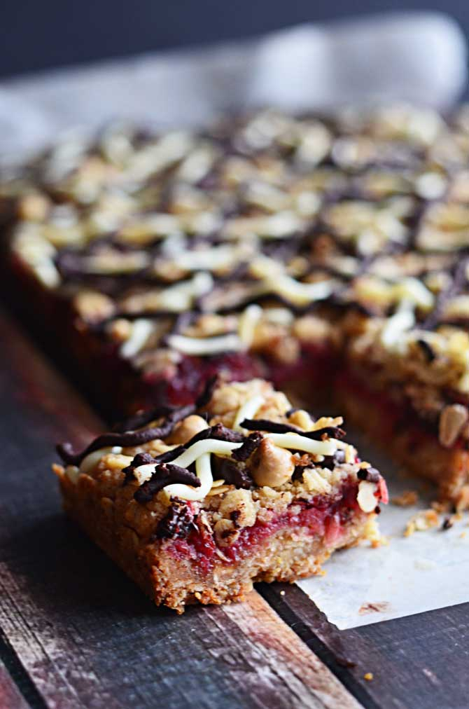 Oatmeal Chocolate Cranberry Bars!  These sweet dessert cookie bars were a hit with my family and friends!  Easy to make, and you can use Thanksgiving's leftover cranberry sauce in them.  | hostthetoast.com