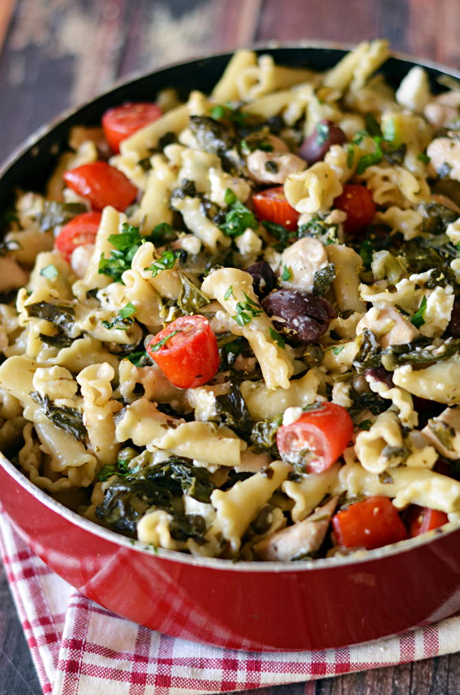 One Pot Greek Chicken Pasta with Creamy Feta Wine Sauce.  You don't even need to boil the noodles first-- just cook it all in one pot!  Easy and impressive dinner. | hostthetoast.com