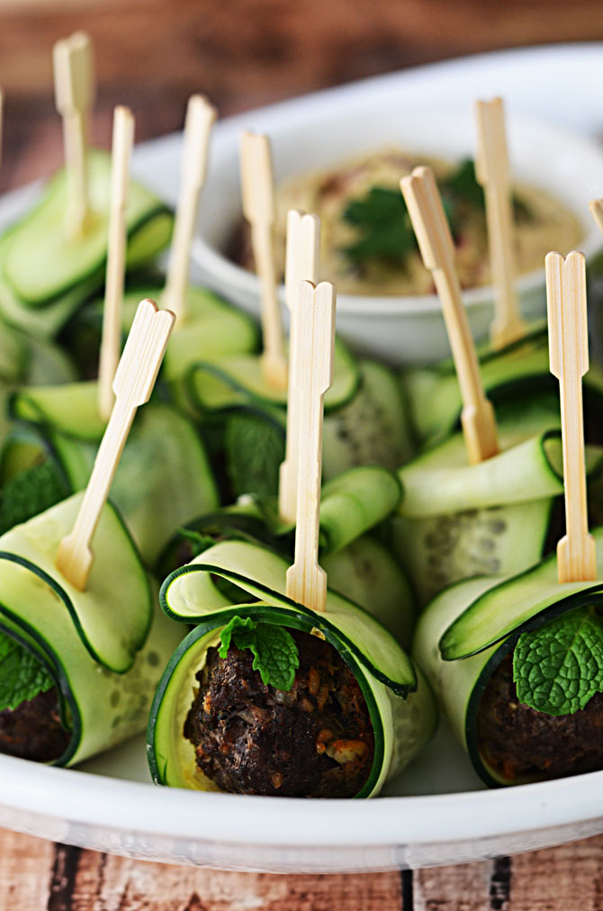 Cucumber Wrapped, Feta Stuffed Meatballs.  These Mediterranean-inspired meatballs are a HIT as an appetizer, and they're healthier than the usual options!  Served with hummus or tzatziki, they are perfect for parties!    hostthetoast.com