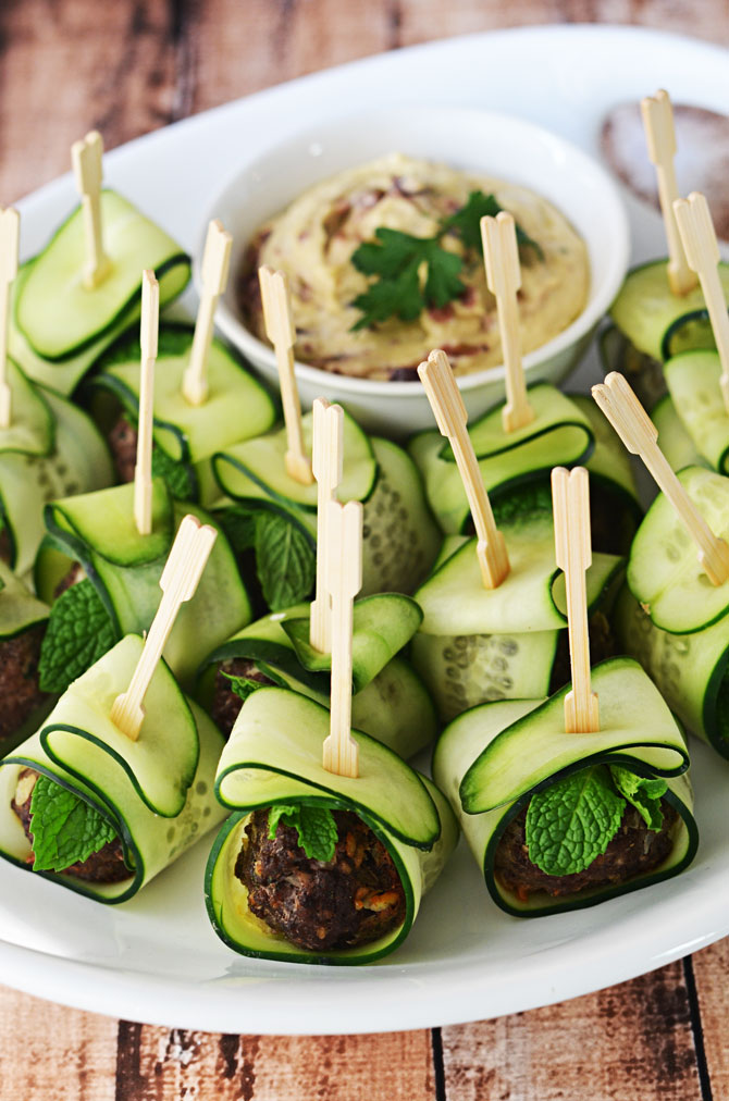 Cucumber Wrapped, Feta Stuffed Meatballs.  These Mediterranean-inspired meatballs are a HIT as an appetizer, and they're healthier than the usual options!  Served with hummus or tzatziki, they are perfect for parties!  | hostthetoast.com
