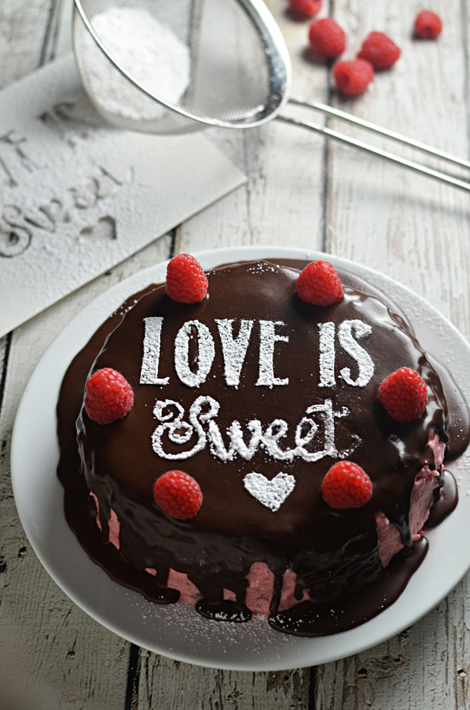 Sugar Stencil Raspberry Dark Chocolate Cake.  Ultra moist dark chocolate cake, raspberry frosting, and simple dark chocolate ganache make a tasty cake that's topped with a sweet powdered sugar message. Great for a birthday or Valentine's Day! | hostthetoast.com