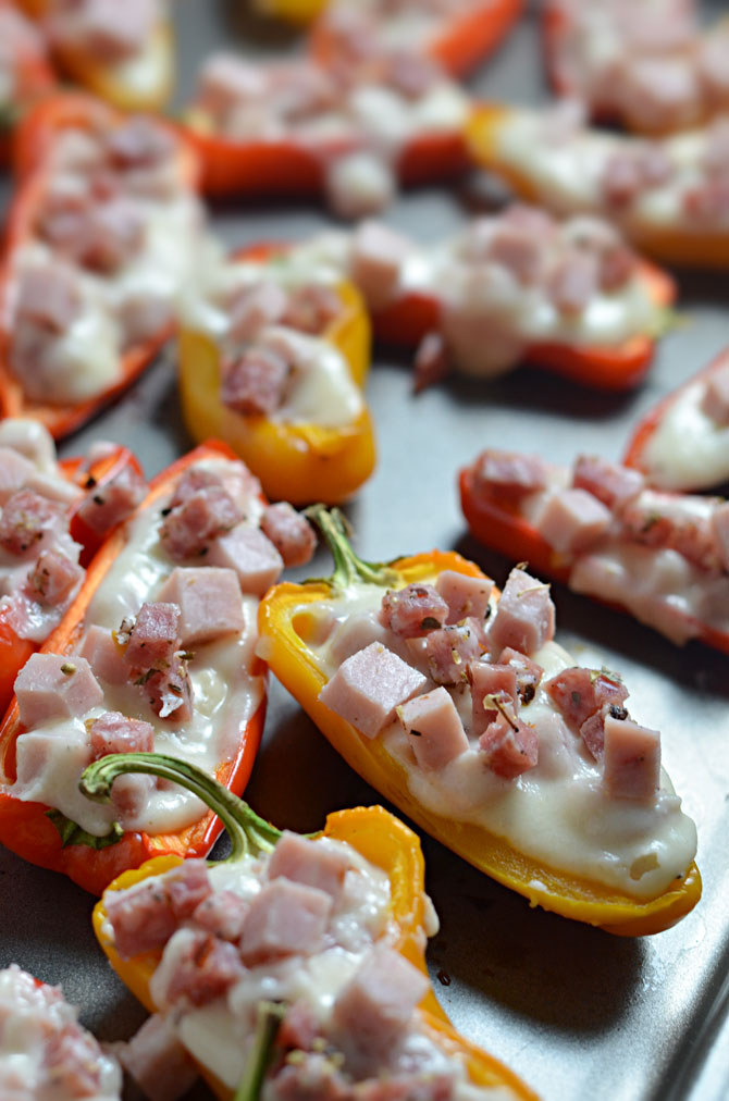 Italian Stuffed Sweet Pepper Poppers. A tasty alternative to jalapeno poppers for people who like less heat.  These vibrant pepper poppers are loaded up with ham, salami, and sharp provolone sauce. YUM! | hostthetoast.com