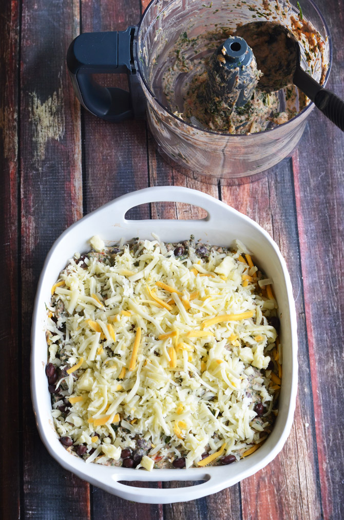 Cheesy Fiesta Black Bean Spinach Dip. This dip is bound to be a new favorite, and it's easy to make! Bake it for Cinco de Mayo or your next party. It's ADDICTIVE.   hostthetoat.com