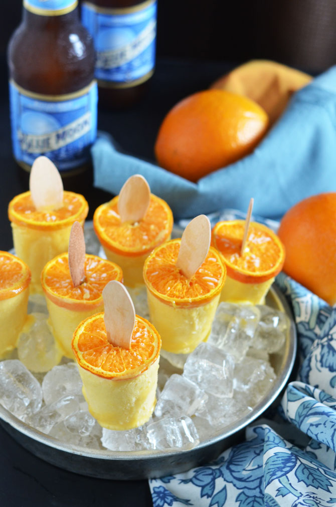 Blue Moon Orange Creamsicles. These boozy popsicles will be the star of your BBQ or party! Easy to make, too! | hostthetoast.com