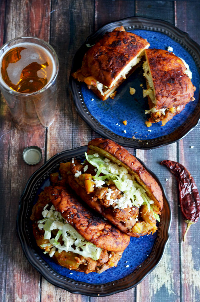 Pambazos (Mexican Salsa-Dunked Sandwiches). They're filled with potatoes, chorizo sausage, and refried beans!   hostthetoast.com