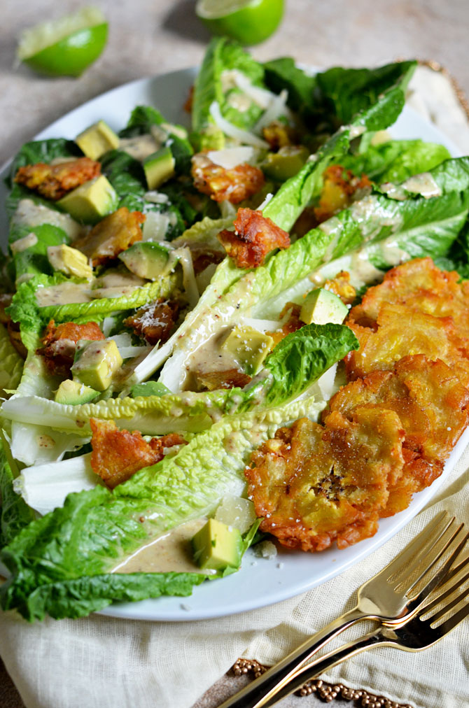Cuban Caesar Salad. This twist on the classic Caesar features tostones, avocado, manchego cheese, and a zesty dressing that I can't get enough of. | hostthetoast.com