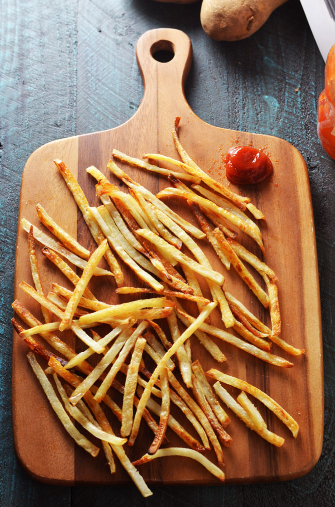 Baked French Fries. These thin, crispy, fluffy fries are just as addictive as the fast food version, but healthier and super easy to make! | hostthetoast.com