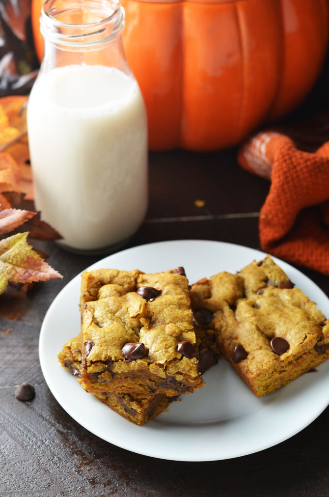 Pumpkin Chocolate Chip Cookie Bars. Perfect for fall and winter, these soft, pumpkin spiced desserts are a hit, and easy to make from scratch! | hostthetoast.com