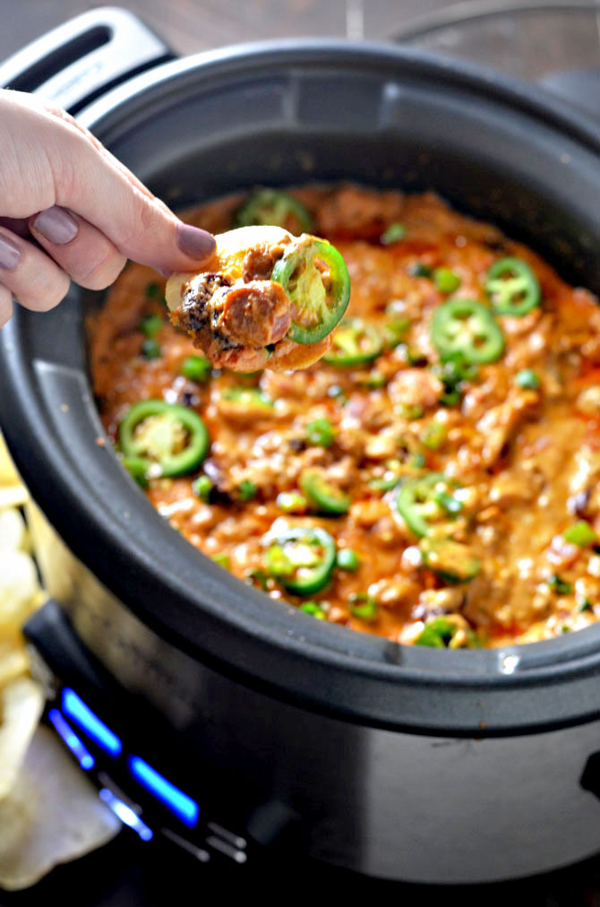 Slow Cooker Chili Cheese Dog Dip. This from-scratch dip is loaded with chili cheese dog flavor and really simple to make. Keep it warm in the slow cooker and serve it for the Super Bowl! | hostthetoast.com