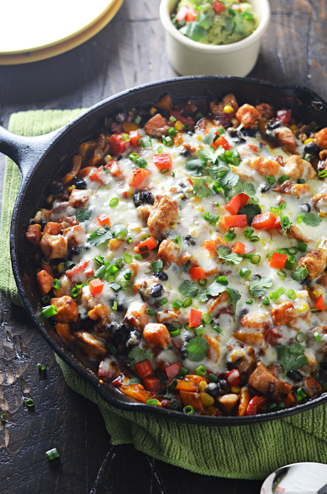 Southwestern Chicken and Sweet Potato Skillet. This is my new go-to weeknight dinner. Spicy, cheesy, and full of healthy ingredients. | hostthetoast.com