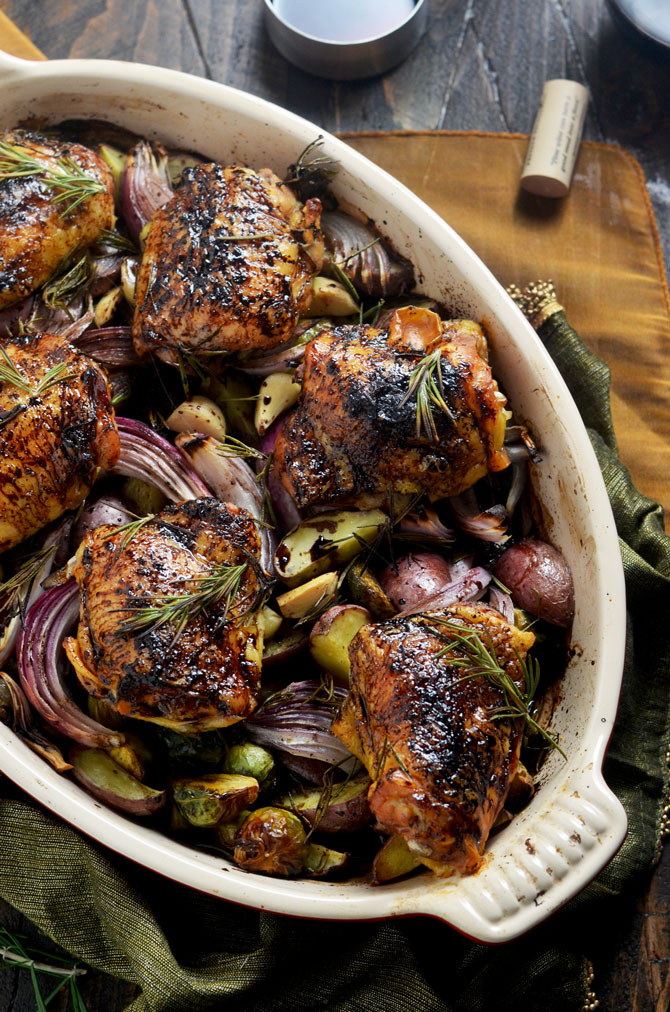 Balsamic-Red Wine Roasted Chicken and Vegetables. Tender, juicy, crispy-skinned chicken thighs brushed with a sweet and tangy reduction, served with roasted potatoes, brussels sprouts, whole garlic cloves, and red onion. Talk about flavorful. | hostthetoast.com