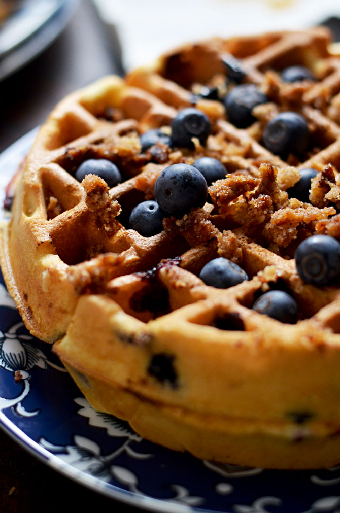 Blueberry Muffin Waffles with Cinnamon Streusel and Vanilla Glaze. These fresh blueberry loaded waffles are dense and taste just like bakery muffins but with a crisp, lightly toasted exterior. Make them a sweet treat with streusel and vanilla glaze, or simply serve them with a pat of butter. Great for a breakfast or brunch get-together. | hostthetoast.com