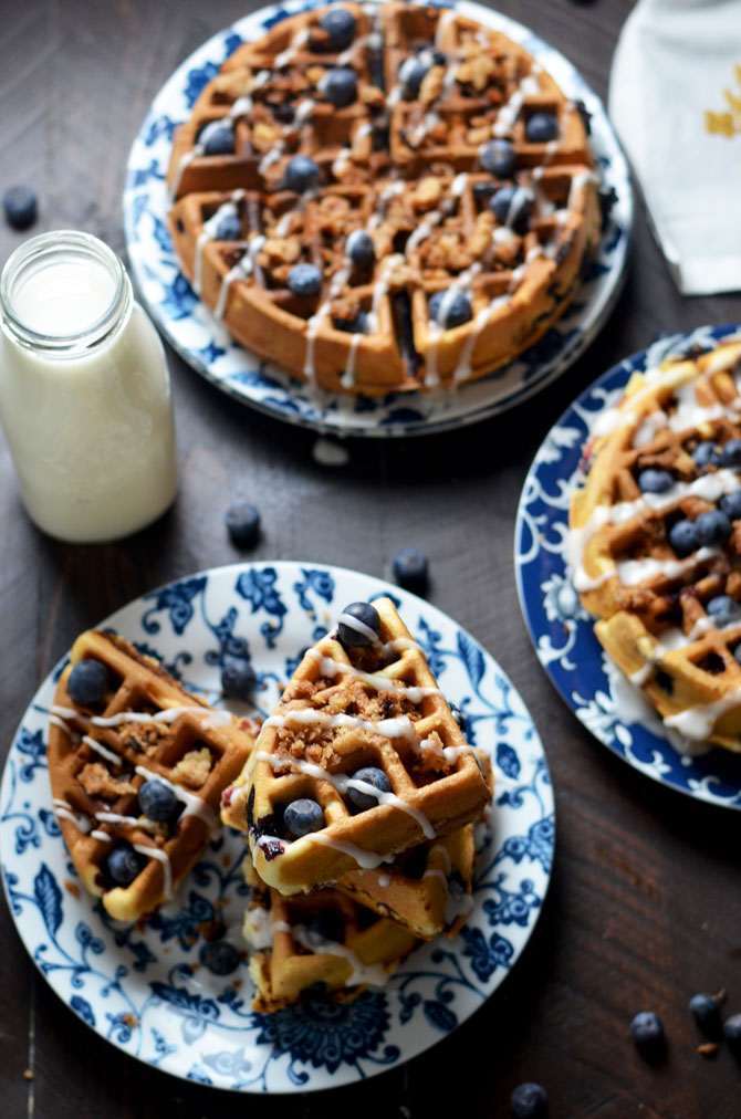 Blueberry Muffin Waffles with Streusel and Vanilla Glaze. These fresh blueberry loaded waffles are dense and taste just like bakery muffins but with a crisp, lightly toasted exterior. Make them a sweet treat with streusel and vanilla glaze, or simply serve them with a pat of butter. Great for a breakfast or brunch get-together.   hostthetoast.com
