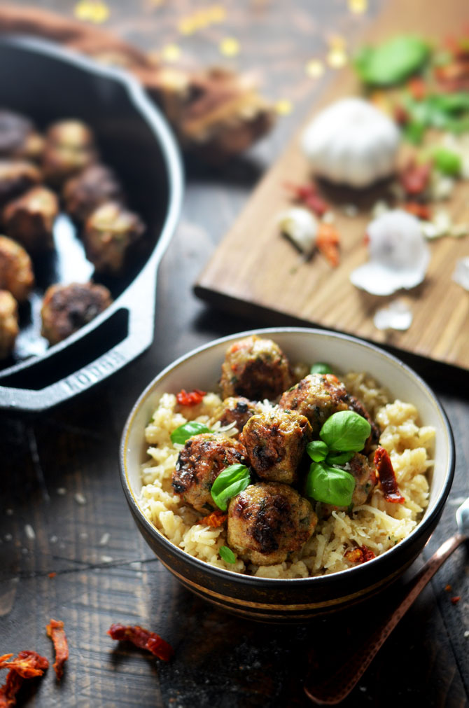 Sun-Dried Tomato Basil Chicken Meatballs with Creamy Parmesan Rice. Tender chicken meatballs, studded with sun dried tomatoes, fresh basil, and plenty of garlic over creamy, parmesan and garlic rice will become a new family favorite dinner. | hostthetoast.com