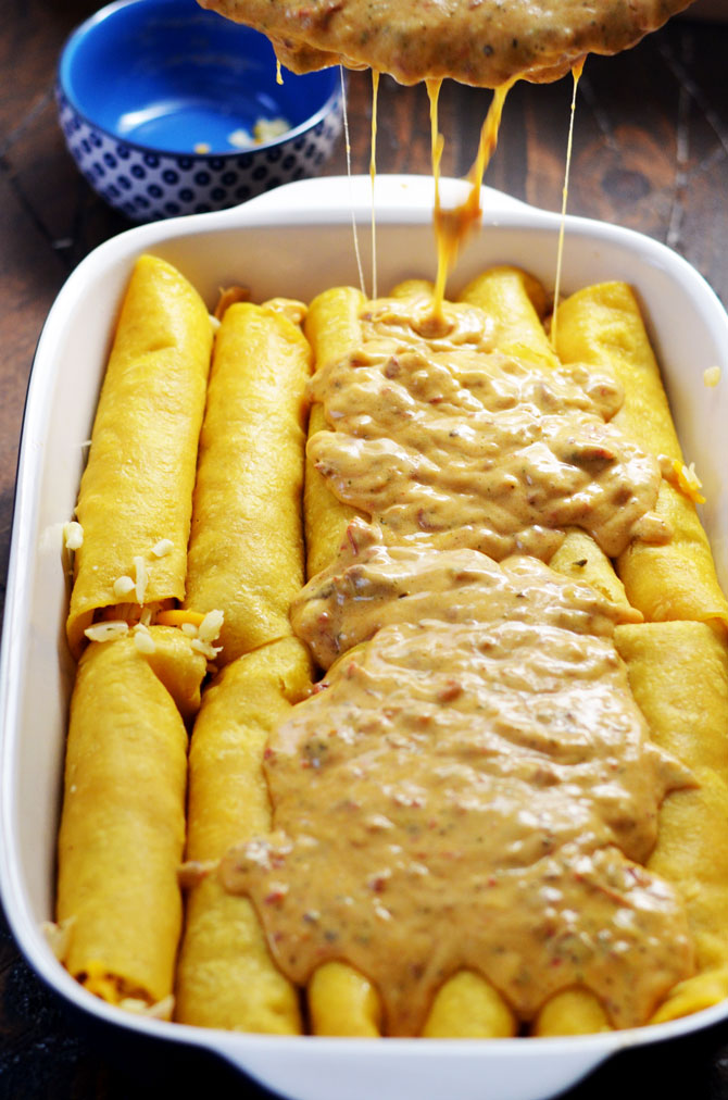Creamy Three Cheese Chipotle Chicken Enchiladas. The title says it all. These slightly spicy, super cheesy, creamy, and ranch seasoned shredded chicken enchiladas are one of my favorite meals to come out of my kitchen! | hostthetoast.com