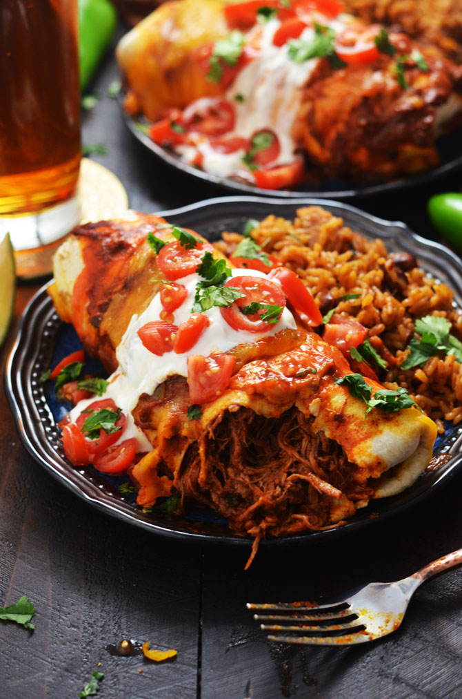 Slow Cooker Smothered Beef Burritos. These flavor-packed Tex-Mex burritos feature crock pot shredded beef and a seriously delicious tomato-chili gravy!   hostthetoast.com