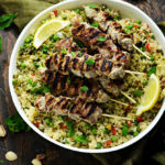 Yogurt Marinated Lamb Skewers with Mint-Pistachio Pesto Pilaf