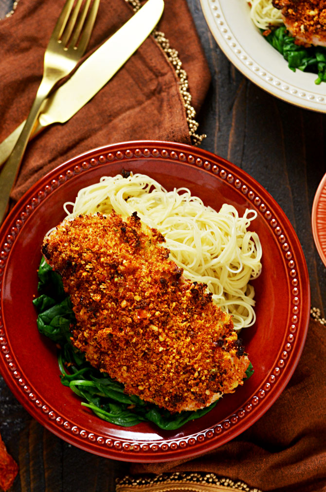 Sun Dried Tomato Crusted Chicken with Goat Cheese and Herb Sauce. Make chicken breasts into an exciting dinner that's easy enough for a weeknight but impressive enough for a date night. The crumb mixture gives the chicken crunch while a dijon mustard and light mayonnaise mixture keeps it moist! | hostthetoast.com