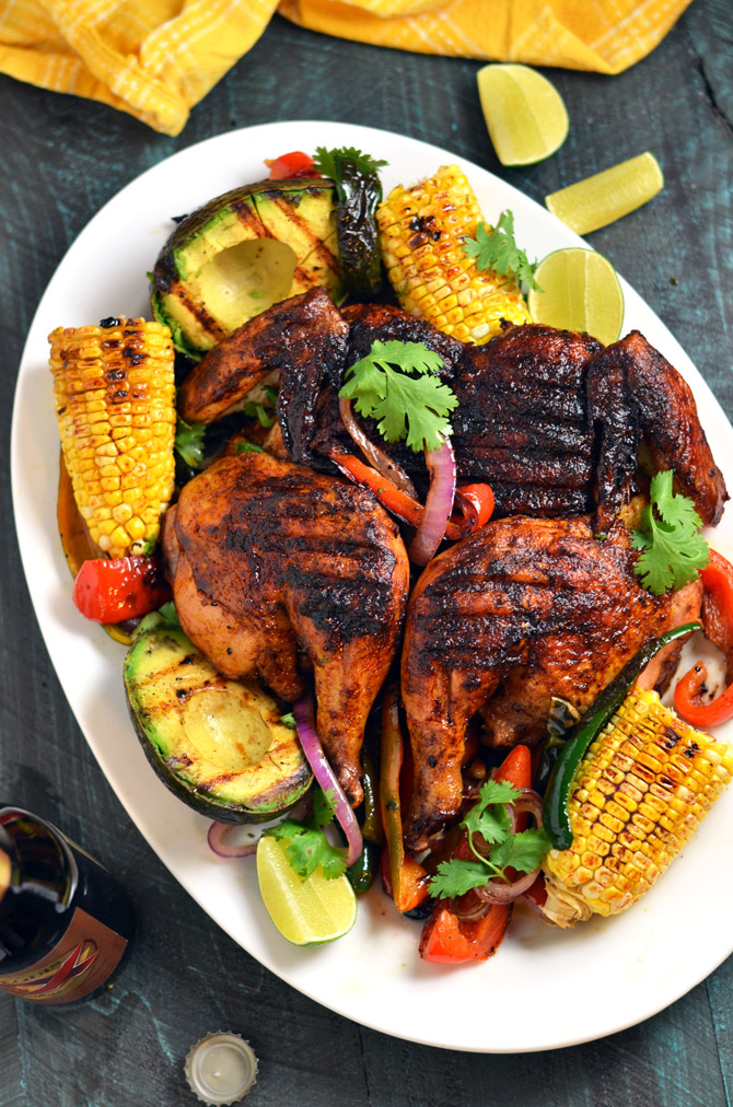 Mexican Brick Chicken with Grilled Corn and Avocados. Crispy and spicy on the outside, moist and juicy on the inside-- this grilled chicken recipe is by far the best out there. | hostthetoast.com