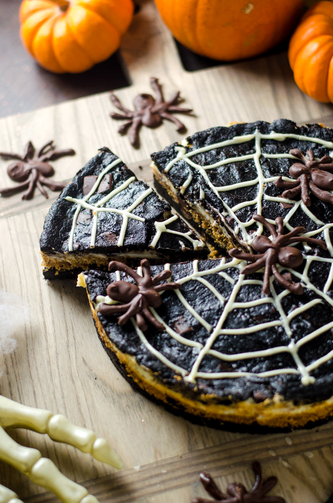 Spider Web S'more Cheesecake Brownies. This layered dessert features dark chocolate brownies, marshmallow cheesecake, and chocolate spiders. It's going to be a hit at your Halloween party! | hostthetoast.com