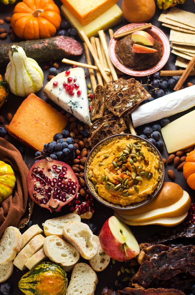 How To Make The Ultimate Autumn Harvest Cheese Board. Tips on selecting the best ingredients, plus recipes for Smoky Chipotle Pumpkin Hummus, Candied Bacon, and Bourbon Apple Butter! This is how you REALLY do Thanksgiving appetizers. | hostthetoast.com
