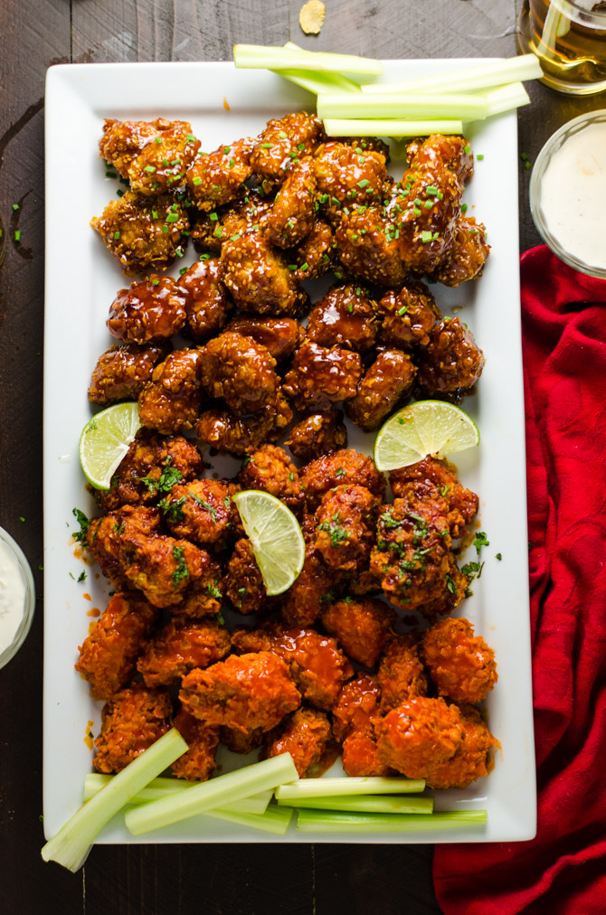 Baked Boneless Wings 4 Ways. Cornflake-coated chicken breast pieces are tossed in homemade Buffalo Sauce, Smoky Chipotle-Lime Sauce, Honey, Bourbon BBQ Sauce, and Orange Glaze. Simple, delicious, and a surefire crowd-pleaser. | hostthetoast.com