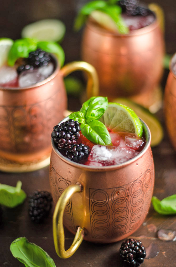 Blackberry Basil Moscow Mules. If you're a Moscow Mule fan, you're going to love this vibrant, simple spin on the popular cocktail! | hostthetoast.com