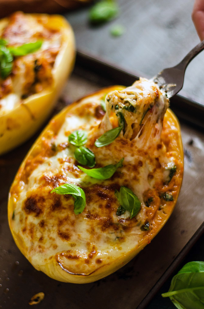 Cheesy Tuscan Spaghetti Squash. This delicious dinner recipe features low-calorie roasted spaghetti squash, a creamy tomato-garlic yogurt sauce, spinach, and plenty of melted cheese. | hostthetoast.com