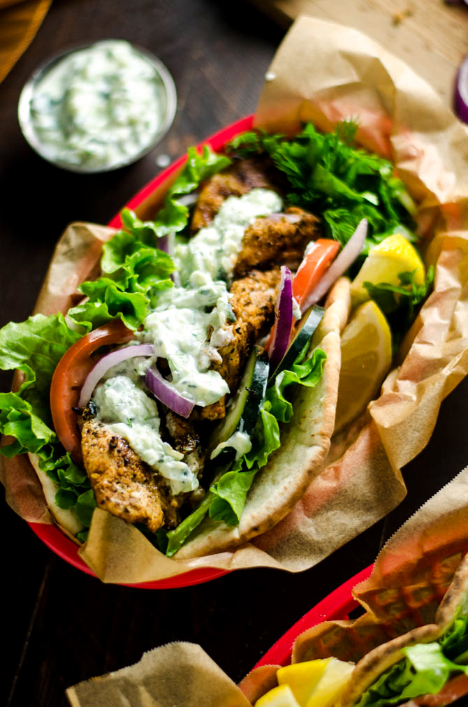 30 Minute Chicken Gyros with Tzatziki. These super easy-to-make Greek-style sandwiches are filled with lemony chicken and cooling cucumber tzatziki. Perfect for a weeknight! | hostthetoast.com