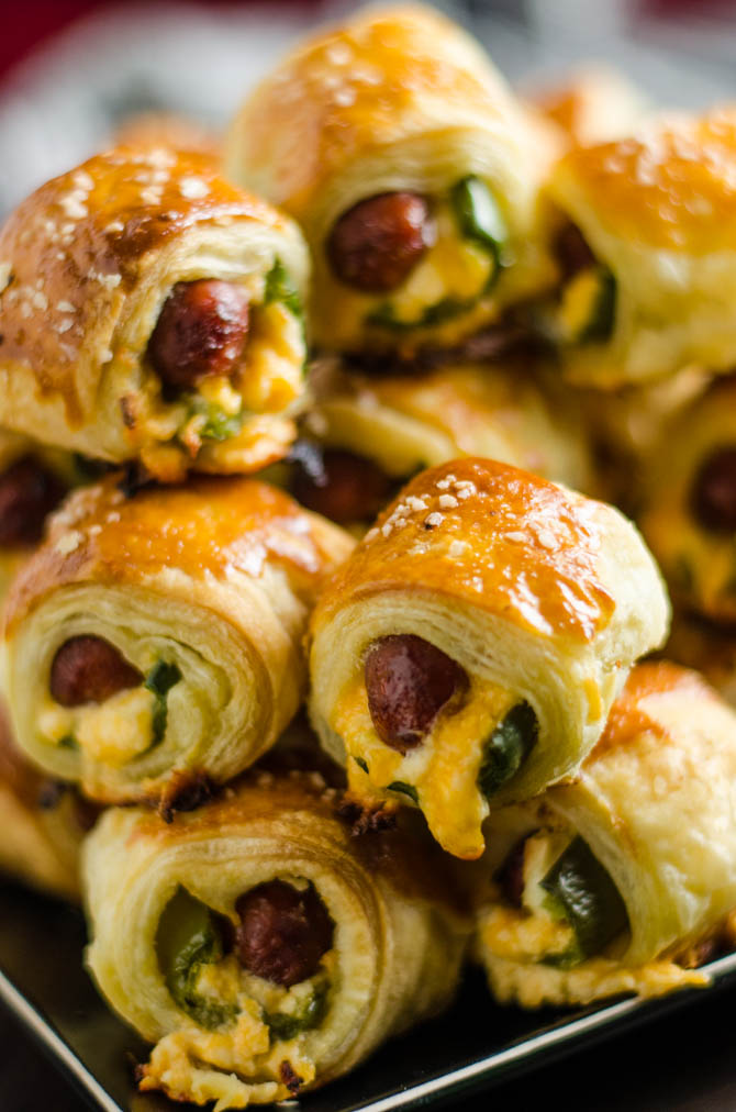 Jalapeno Popper Pigs in a Blanket. These spicy, cheesy appetizers are perfect for your next party or game day! | hostthetoast.com