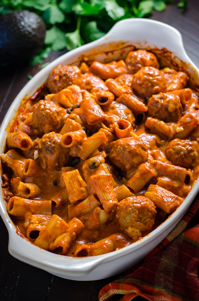 Enchilada Meatball Pasta Bake. This simple, saucy, cheesy dinner comes together all in one dish-- no pre-browning the meatballs or pre-boiling the pasta necessary. | hostthetoast.com