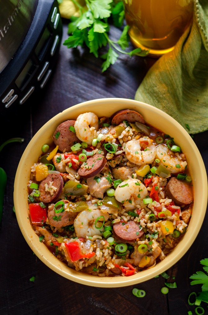 Slow Cooker Jambalaya. A low-effort meal that yields some high-level flavors, this cajun-inspired dish is loaded up with shrimp, chicken, and andouille sausage! | hostthetoast.com