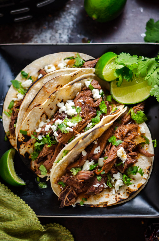 Slow Cooker Ancho Coffee Shredded Beef. This easy-to-make, tender slow cooked beef is perfect for piling into tacos, onto sandwiches, or serving over mashed potatoes.   hostthetoast.com