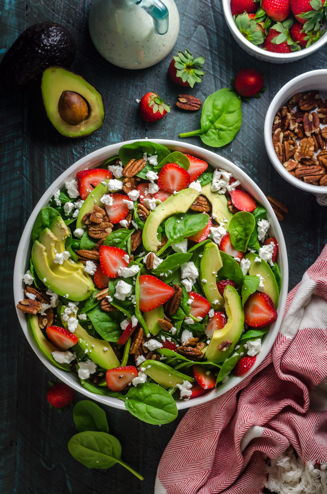Strawberry Avocado Spinach Salad with Greek Yogurt Poppy Seed Dressing. This simple salad is full of creamy, crunchy, nutty, fruity, tangy, and summer-friendly flavors. You're gonna love it!   hostthetoast.com