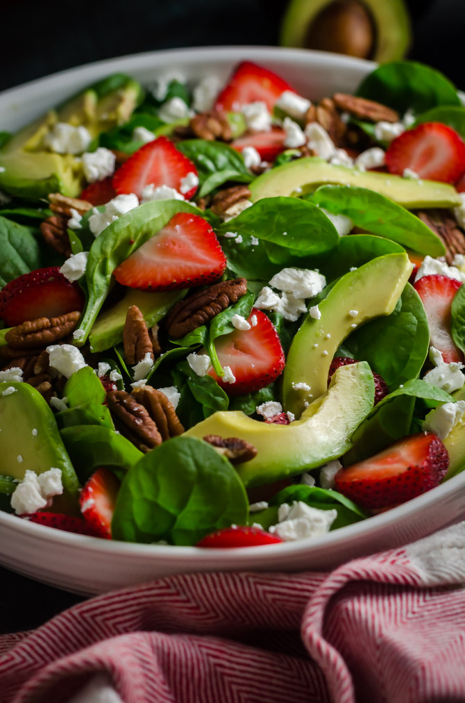 Strawberry Avocado Spinach Salad with Greek Yogurt Poppy Seed Dressing. This simple salad is full of creamy, crunchy, nutty, fruity, tangy, and summer-friendly flavors. You're gonna love it! | hostthetoast.com