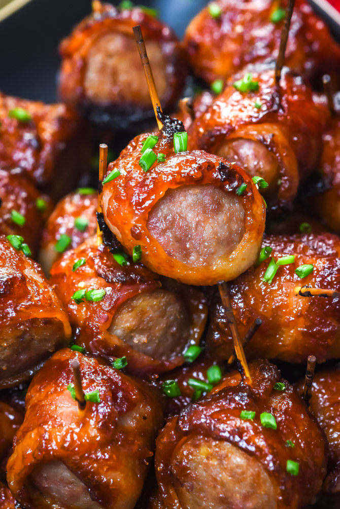 5 Ingredient Bacon-Wrapped Bratwurst Bites. Just wait til you see how easy these sweet, spicy, smoky appetizer bites are to make! | hostthetoast.com